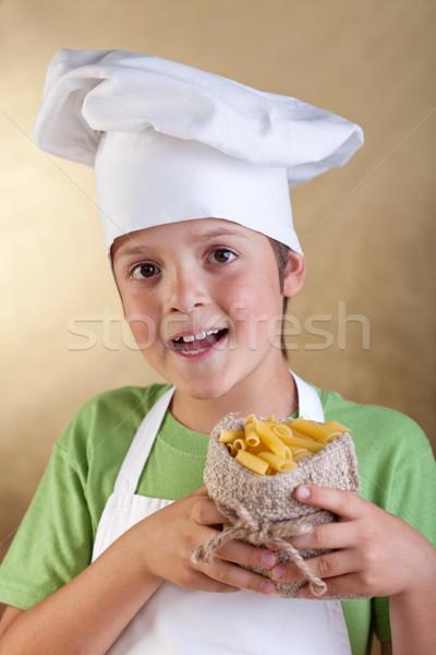 Vidám fiú szakács sapka tart nyers tészta kicsi Stock fotó © ilona75