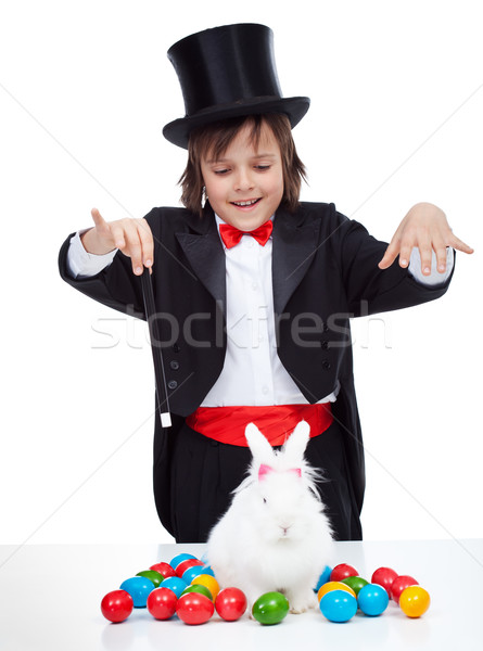 Young magician boy performing an easter trick Stock photo © ilona75