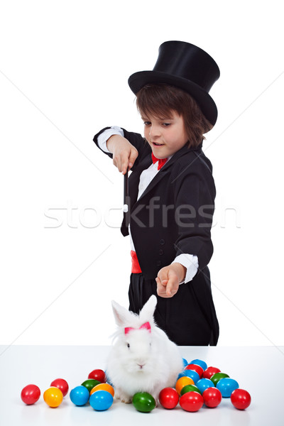 Magician boy doing an easter trick Stock photo © ilona75