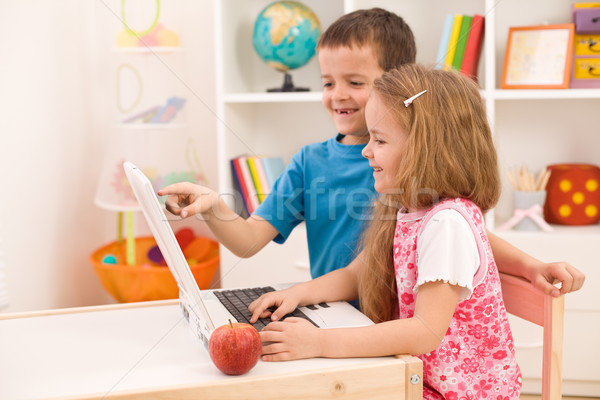 Stock photo: Kids playing on laptop computer at home