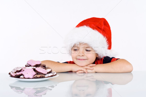 Boy admiring the christmas gingerbread cookies Stock photo © ilona75