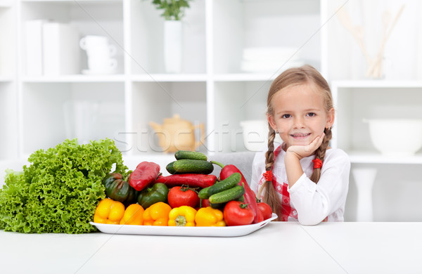 Happy girl with various vegetables Stock photo © ilona75