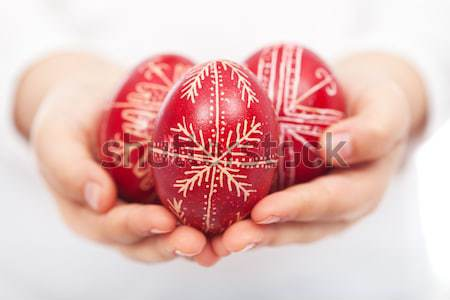 Woman and child hands holding easter eggs Stock photo © ilona75