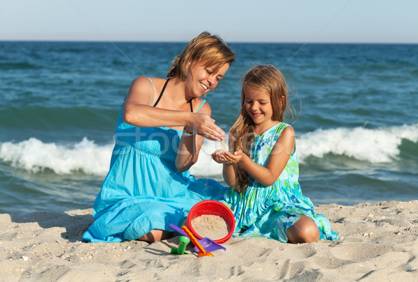 Woman and little girl on the beach Stock photo © ilona75