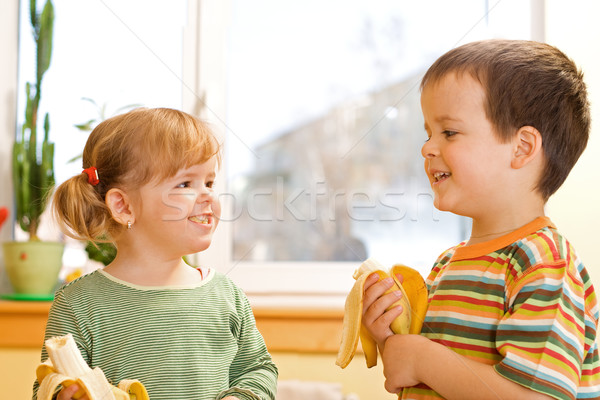 Two kids eating bananas Stock photo © ilona75