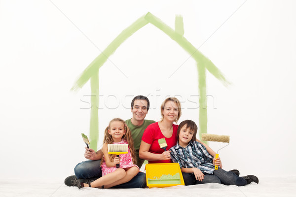 Happy couple with two kids repainting their home Stock photo © ilona75