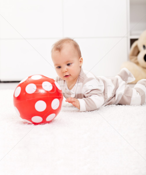 Baby girl with red ball Stock photo © ilona75