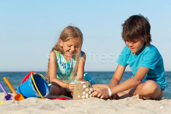 Stok fotoğraf: Oynayan · çocuklar · plaj · Bina · kız · gülümseme