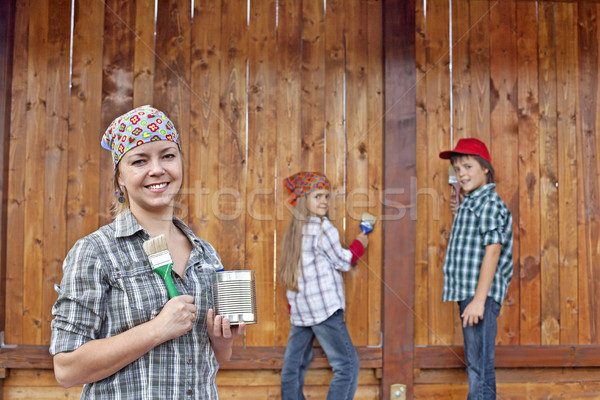 Woman and kids painting the wood shed Stock photo © ilona75
