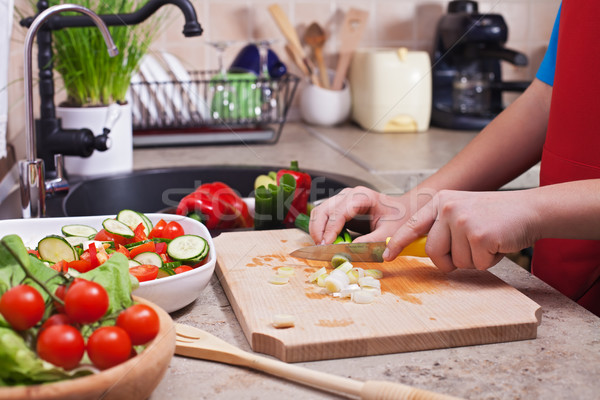 Child hands chopping vegetables on cutting board - the spring on Stock photo © ilona75