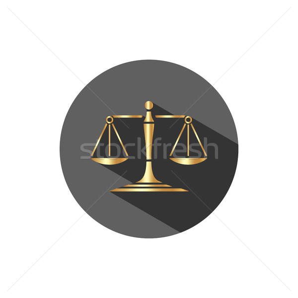 Golden scales of justice icon with shadow on a dark circle