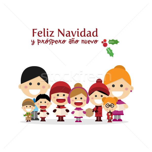 Cute family singing carols at Christmas Night. Spanish title Stock photo © Imaagio