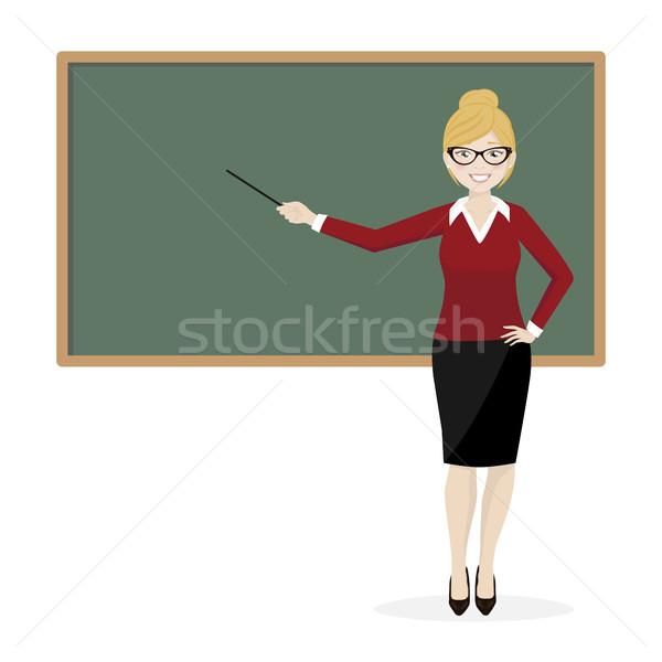 Szőke tanár magyaráz iskolatábla osztályterem osztály Stock fotó © Imaagio