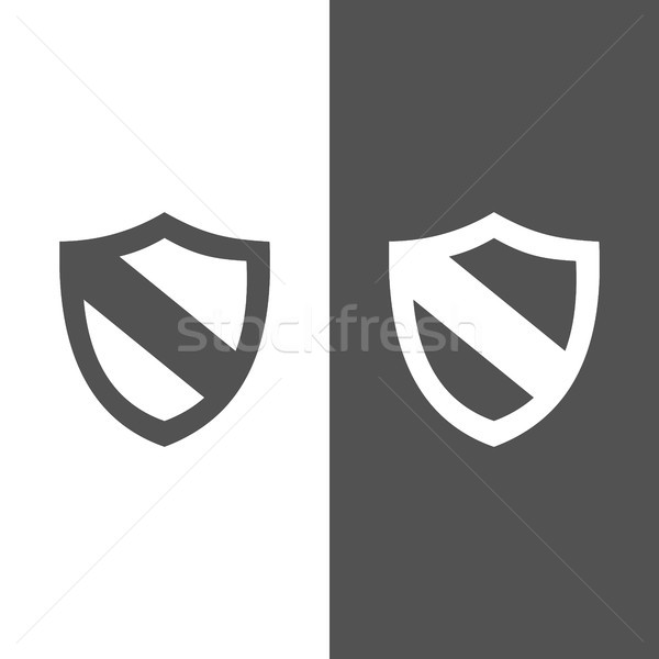 Protection shield icon on black and white background Stock photo © Imaagio