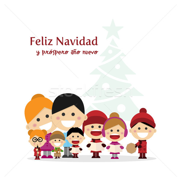 Cute family singing carols at Christmas Night with tree background. Spanish title Stock photo © Imaagio