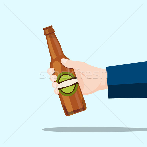 Right hand holding a beer bottle and blue background Stock photo © Imaagio