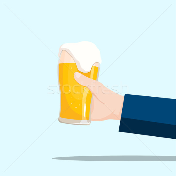 Right hand holding a beer glass on a blue background Stock photo © Imaagio