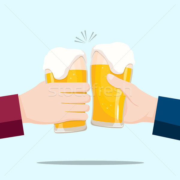 People celebrating with beer glasses and blue background Stock photo © Imaagio