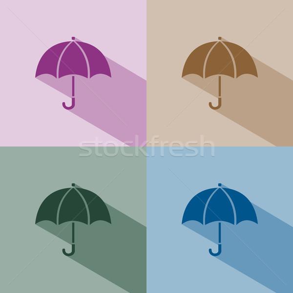 Umbrella icon with shade on winter colored background Stock photo © Imaagio