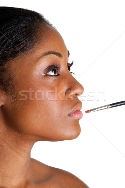 Young woman applying a lip brush Stock photo © Imabase