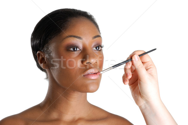 Genç kadın dudak fırçalamak görüntü kadın Stok fotoğraf © Imabase