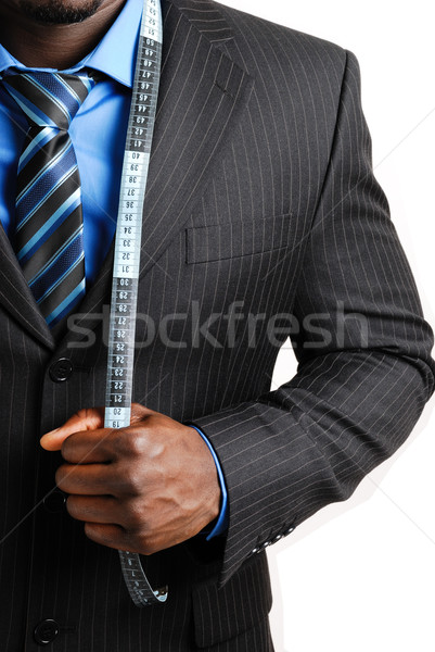 Business man with tape measure Stock photo © Imabase