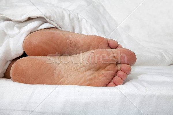 Feet in bed Stock photo © Imagecom