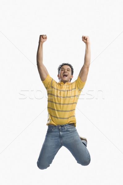 человека прыжки волнение моде весело джинсов Сток-фото © imagedb