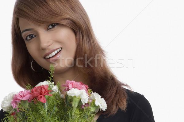 Portrait femme bouquet œillet fleurs Photo stock © imagedb