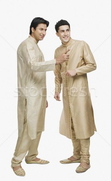 Férfi beszél barát mutat ujj mosolyog Stock fotó © imagedb