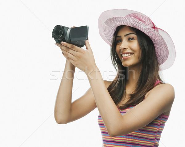 Közelkép nő otthon videókamera jókedv fiatal Stock fotó © imagedb