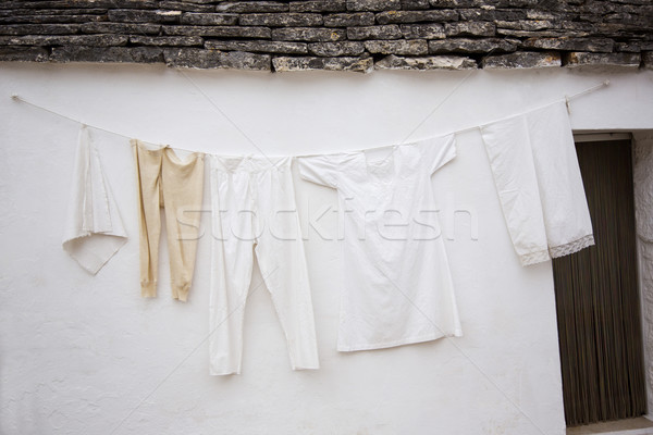 Clothes drying outside a trulli house Stock photo © imagedb