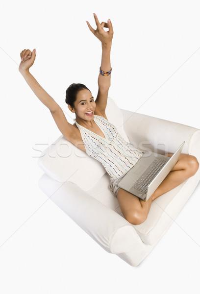Nő laptopot használ néz izgatott mosoly internet Stock fotó © imagedb