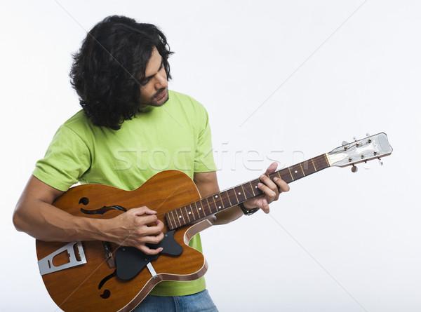 Közelkép férfi játszik gitár zene divat Stock fotó © imagedb