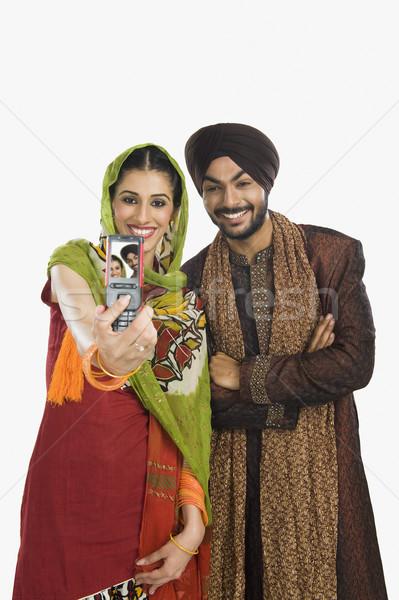 Sikh casal quadro telefone móvel tecnologia Foto stock © imagedb