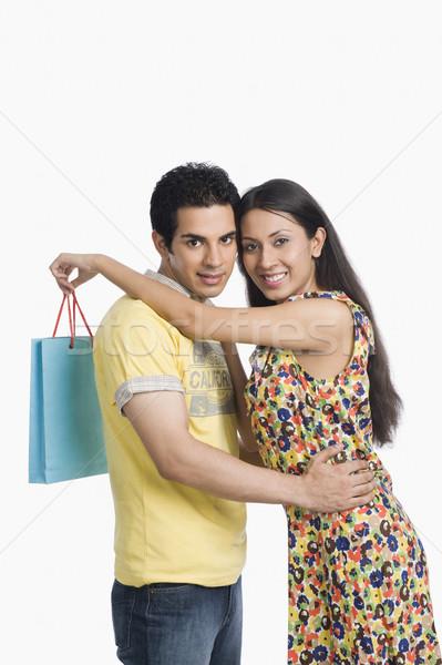 カップル 立って 腕 周りに ショッピング 笑みを浮かべて ストックフォト © imagedb