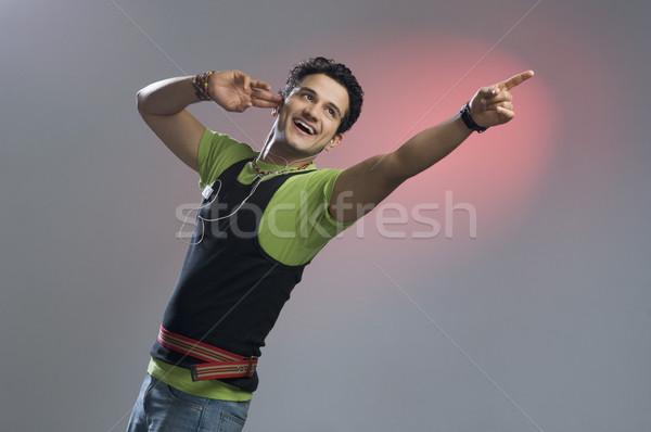 Mann Musik hören Hinweis Finger Spaß cool Stock foto © imagedb