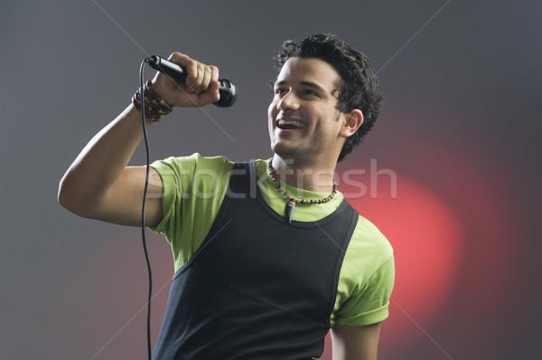 Férfi énekel jókedv modern szórakoztatás tart Stock fotó © imagedb