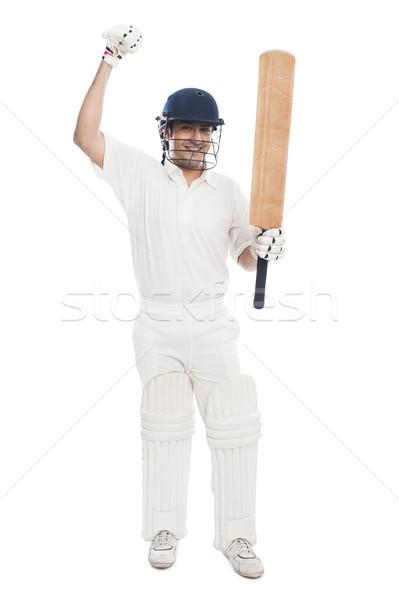 Cricket batsman celebrating his success Stock photo © imagedb