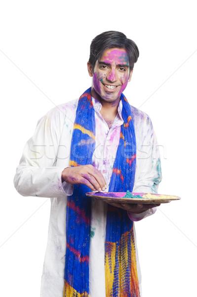 Férfi tart tányér por festék jókedv Stock fotó © imagedb