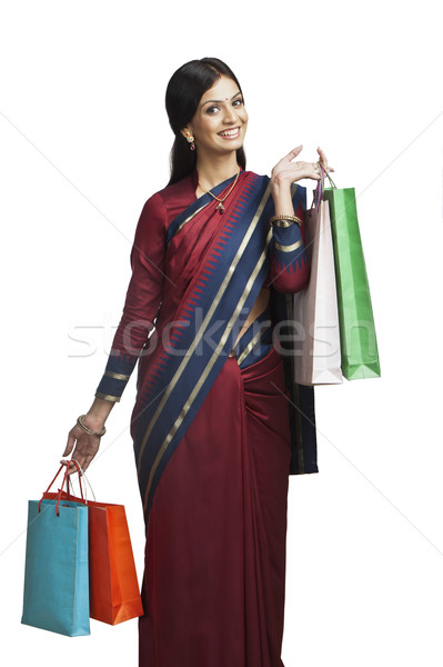 Traditionally Indian woman holding shopping bags Stock photo © imagedb
