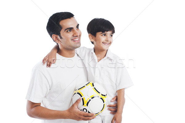 Stock photo: Happy father and son with football