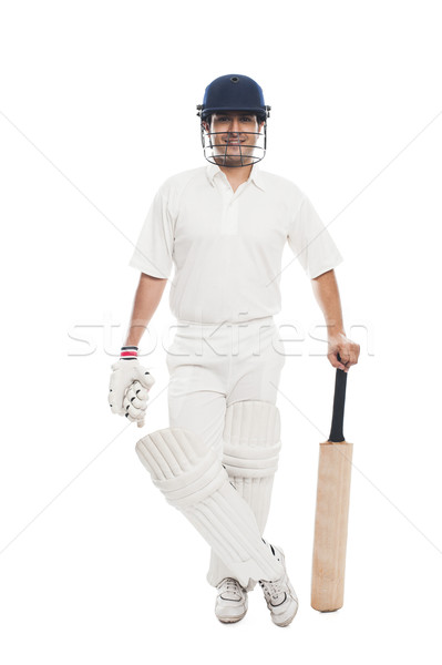 Portrait of a batsman standing with a cricket bat Stock photo © imagedb