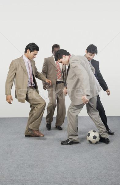 Quattro imprenditori giocare soccer ball business imprenditore Foto d'archivio © imagedb