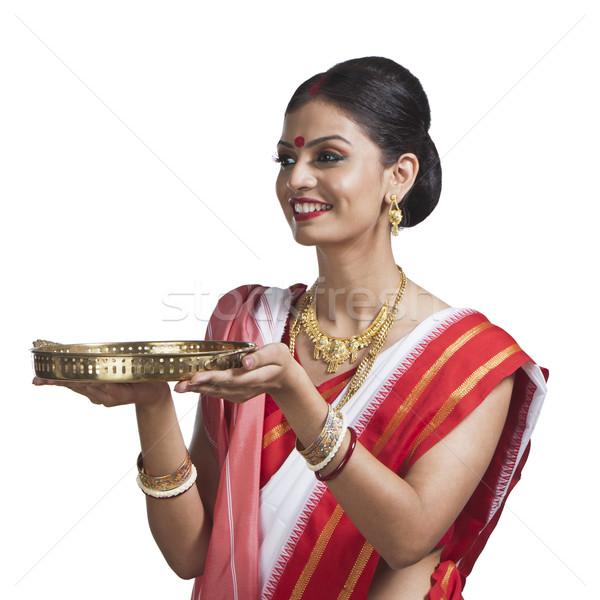 Traditional Bengali woman holding pooja thali Stock photo © imagedb