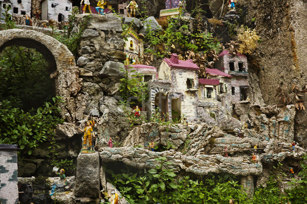 Miniature houses on the rocks Stock photo © imagedb