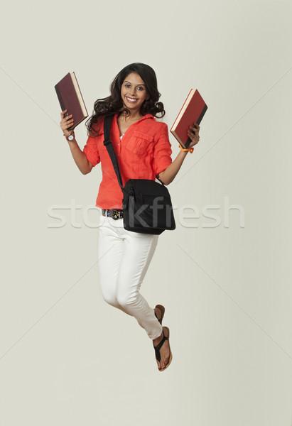 Kadın kitaplar atlama kitap öğrenci Stok fotoğraf © imagedb
