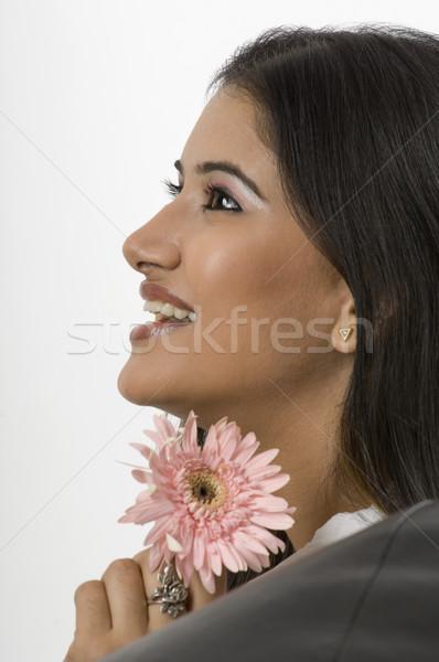 женщина улыбается цветок женщину улыбка Сток-фото © imagedb
