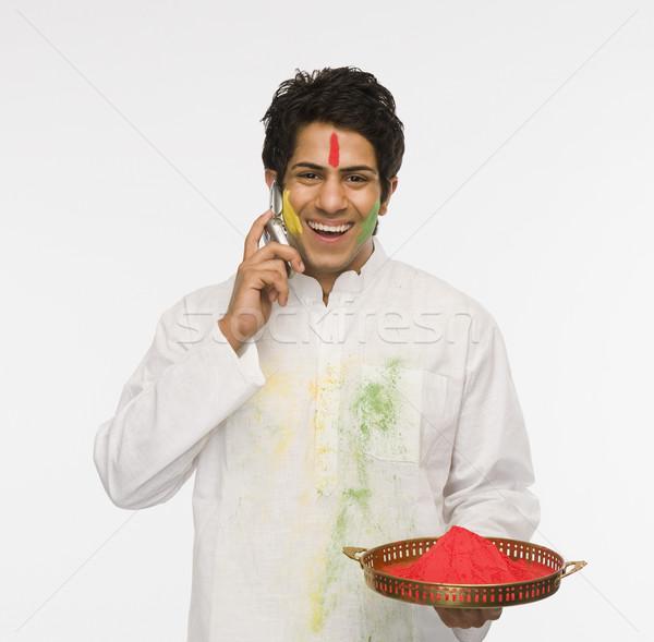 человека цветами говорить мобильного телефона краской Сток-фото © imagedb