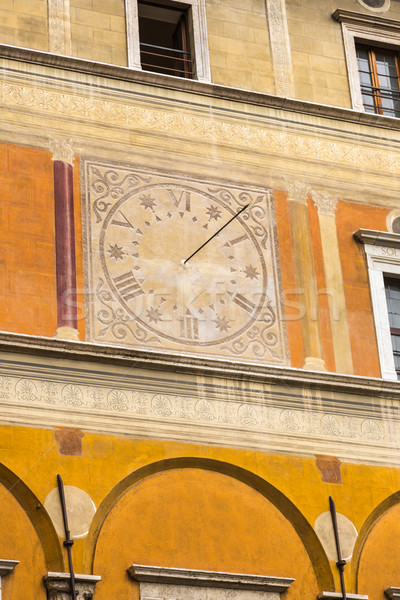 Low angle view of a clock on the wall of a building Stock photo © imagedb